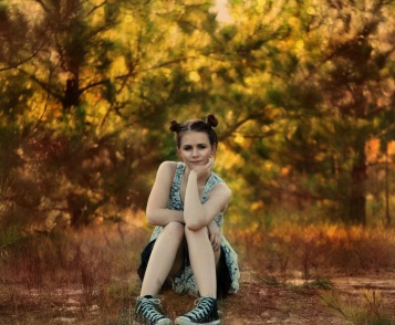 girl-sitting-posing-trees